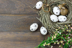 Easter background.Happy easter eggs pained also rabbin. Top view easter background.Happy easter eggs pained also rabbin and cross on nest.Texture rustic wooden Royalty Free Stock Photography