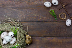 Easter background.Happy easter eggs pained also rabbin. Top view easter background.Happy easter eggs pained also rabbin and cross on nest.Texture rustic wooden Stock Photography