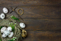 Easter background.Happy easter eggs pained also rabbin. Top view easter background.Happy easter eggs pained also rabbin and cross on nest.Texture rustic wooden Royalty Free Stock Images