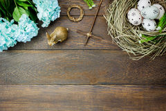 Easter background.Happy easter eggs pained also rabbin. Top view easter background.Happy easter eggs pained also rabbin and cross on nest.Texture rustic wooden Stock Photos