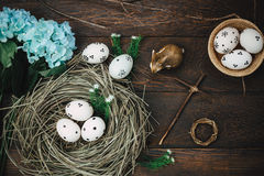 Easter background.Happy easter eggs pained also rabbin. Top view easter background.Happy easter eggs pained also rabbin and cross on nest.Texture rustic wooden Royalty Free Stock Photo