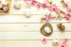 Easter background.Happy easter eggs pained on nest also. Top view easter background.Happy easter eggs pained on nest also beautiful pink flower with rabbit doll Royalty Free Stock Photo
