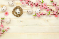 Easter background.Happy easter eggs pained on nest also. Top view easter background.Happy easter eggs pained on nest also beautiful pink flower.Texture rustic Stock Photos