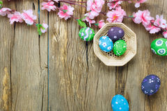 Easter background.Happy easter eggs pained on nest also. Top view easter background.Happy easter eggs pained on nest also beautiful pink flower.Texture rustic Royalty Free Stock Image