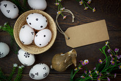 Easter background.Happy easter eggs pained on wood bask. Top view easter background.Happy easter eggs pained on wood basket also beautiful flower and greeting Stock Image