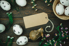 Easter background.Happy easter eggs pained on wood bask. Top view easter background.Happy easter eggs pained on wood basket also beautiful flower and greeting Royalty Free Stock Photo