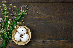 Easter background.Happy easter eggs pained on wood bask. Top view easter background.Happy easter eggs pained on wood basket also beautiful flower.Texture rustic Stock Image