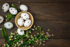 Easter background.Happy easter eggs pained on wood bask. Top view easter background.Happy easter eggs pained on wood basket also beautiful flower.Texture rustic Royalty Free Stock Photography