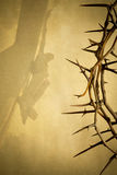 Easter background illustration with Crown of Thorns on Parchment Paper and Jesus Christ on the Cross faded in. Stock Photography
