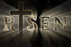 Easter background with Jesus Christ cross and risen text written, engraved, carved on stone. With light coming from behind. Christian, religious Easter card stock images
