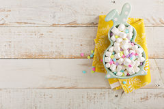 Easter background with marshmallows in bunny plate Stock Image