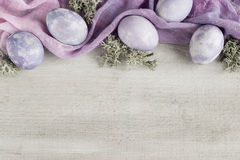 Easter background. Modern serenity and rose quartz colored, Easter eggs on wood background Royalty Free Stock Images