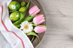 Easter background with painted eggs and spring flowers Stock Image
