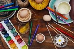 Easter Background. Painting Process of Easter Eggs. Vertical Image. Dark Wood Background. stock photography