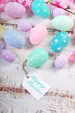 Easter background  with pastel color eggs and greetings on paper Stock Photography