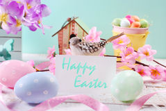 Easter background  with pastel eggs and white  card with greetin Royalty Free Stock Photos