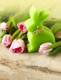 Easter background with pink tulips and bunny decoration. Copy space Royalty Free Stock Images