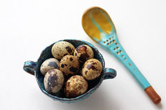 Easter background: quail eggs in bowl and spoon royalty free stock image