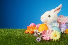 Easter background with rabbit, flowers, and colorful egg. Festive Easter background with rabbit, flowers, and colorful eggs Royalty Free Stock Images