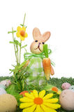 Easter background with a rabbit. An Easter background with a rabbit and some realistic looking chocolate eggs Stock Photo