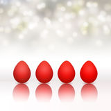 Easter background with red eggs and bokeh. Four red easter eggs with bokeh in background Stock Photography
