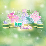 Easter background with ribbon, hares and gifts Stock Photography