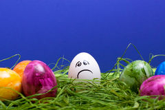 Easter background with sad egg Stock Photos