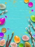 Easter background with space for greeting or message. Pussy-willow branches, paint decorated multicolored eggs Stock Photo
