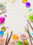 Easter background with space for greeting or message. Pussy-willow branches, paint decorated multicolored eggs Stock Image
