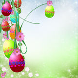 Easter background. Spring or Easter background with Colorful easter eggs and flowers  hanging on ribbons Royalty Free Stock Images