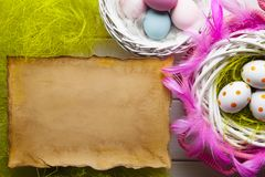 Easter background - White and colored eggs and paper sheet royalty free stock photos