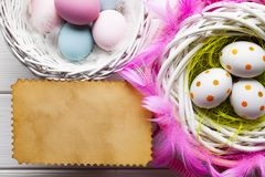 Easter background - White and colored eggs and paper sheet royalty free stock images