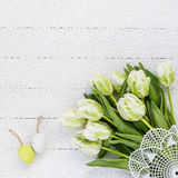 Easter background with white flowers and decorative eggs. Stock Photo