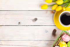 Easter Background With Colorful Eggs And Yellow Tulips Stock Image