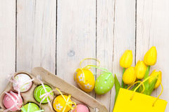 Easter Background With Colorful Eggs And Yellow Tulips Royalty Free Stock Photos