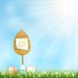 Easter background with wooden sign and eggs Royalty Free Stock Images