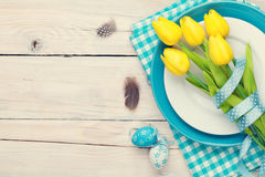 Easter background with yellow tulips and colorful eggs Stock Image
