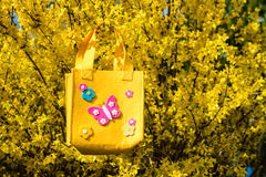Easter bag. Yellow easter bag on a branch Royalty Free Stock Photo