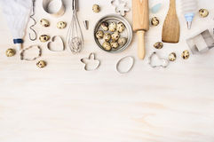 Easter bake tools with quail eggs and biscuit cutter on white wooden background, top view. Place for text royalty free stock photos