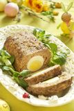 Easter baked meatloaf with boiled eggs Stock Photos