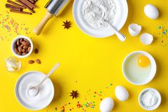 Easter baking background with a space for a text. Easter bakery concept, various products for home holiday baking, such as sugar, butter, yogurt and eggs and Royalty Free Stock Photo