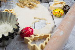 Easter baking preparation. Raw dough and form for the holiday cookies on a wood table. Stock Image