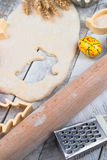 Easter baking preparation. Raw dough and form for the holiday cookies on a wood table. Royalty Free Stock Image