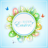 Easter banner with colorful eggs in grass and butterflies Royalty Free Stock Image