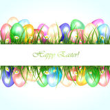 Easter banner with eggs in a grass Stock Image