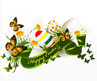 Cute Easter greeting card with banner, green grass, chamomiles a Royalty Free Stock Image