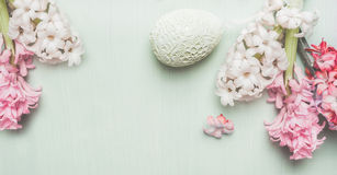 Easter banner with hyacinths and decor egg on light pastel wooden background, top view. Place for text royalty free stock photo
