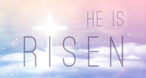 Easter banner with text 'He is risen', shining cross and heaven with white clouds. Stock Photos