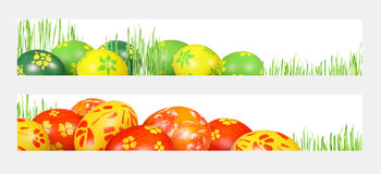 Easter banners. Colorful Easter eggs and green, the young plants out on a white background. Easter banners for the web royalty free stock photo
