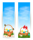 Easter banners with Easter eggs in basket and flow Stock Photos